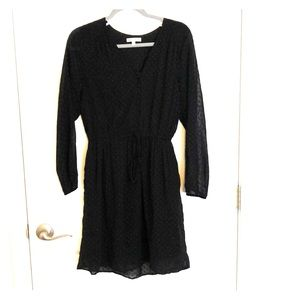 Black textured dress with sheer sleeves